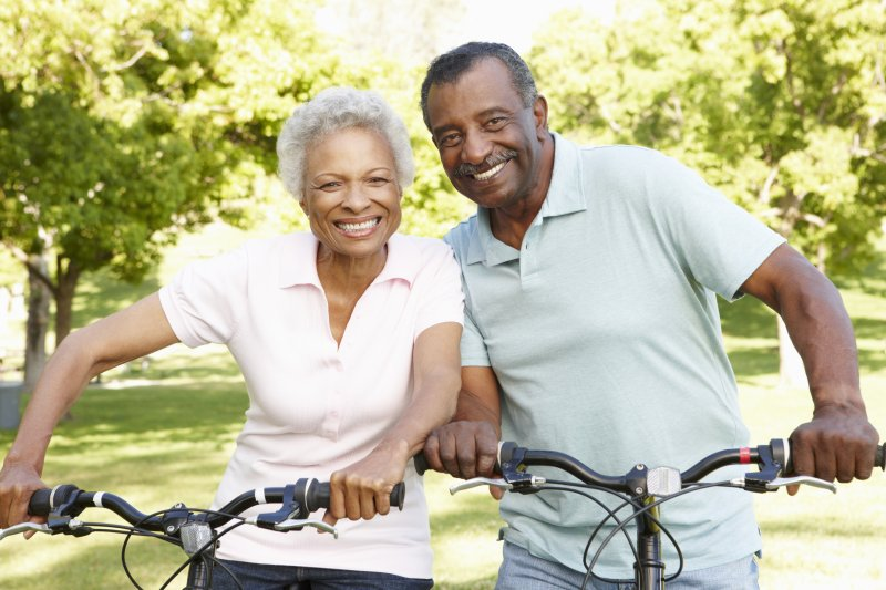 Couple with dental implants smiling